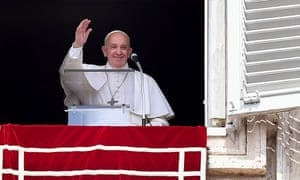 Pope Francis waves to the faithful in St Peter's Square