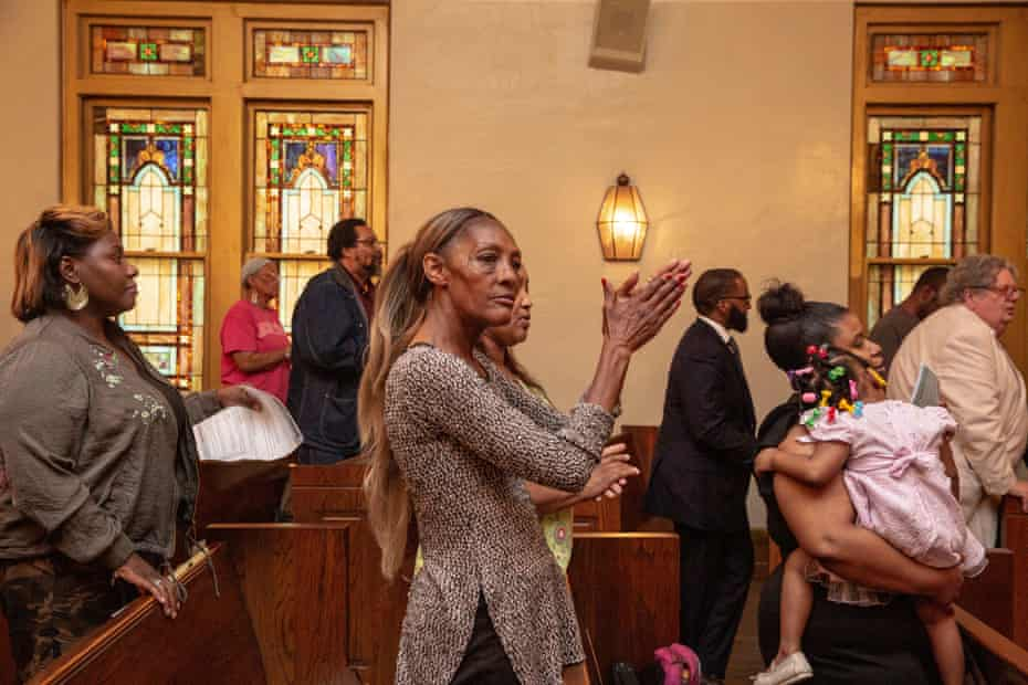 """TCHULA, MS - May 9, 2019: People stand and clap while singing """"Ain't Going To Let Nobody Turn Me 'Round"""" at Good Samaritan Ecumenical Church during a community meeting with the Poor People's Campaign and Rev. Dr. William Barber. Andrea Morales for The Guardian"""