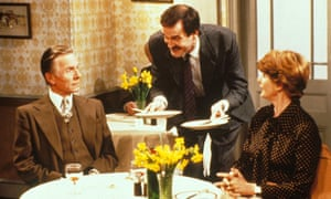 John Cleese in television series Fawlty Towers, which he co-wrote with Connie Booth.