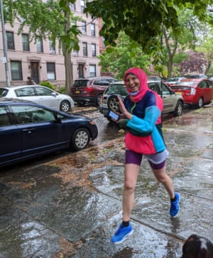 Soaked with rain and nearing the 'finish line' on my street in Brooklyn.