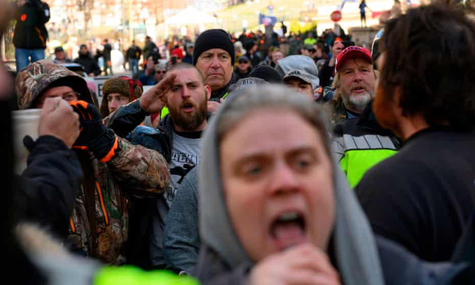 A pro-gun activist shouts at a small group of anti-white supremacy protesters at a rally by gun supporters outside the Virginia state Capitol grounds in January.