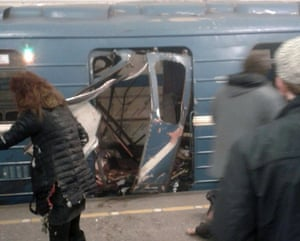 People in front of a damaged train door in a photograph circulated widely on Twitter shortly after an explosion.