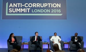 Laura Stefan, the anti corruption coordinator for the Romanian Academic Society, Colombian President Juan Manuel Santos, Sri Lankan President Maithripala Sirisena and business man Strive Masiyiwa take part in a panel discussion at the Anti-Corruption Summit held at Lancaster House