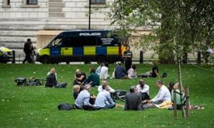 People socialise in St James' Park, London.