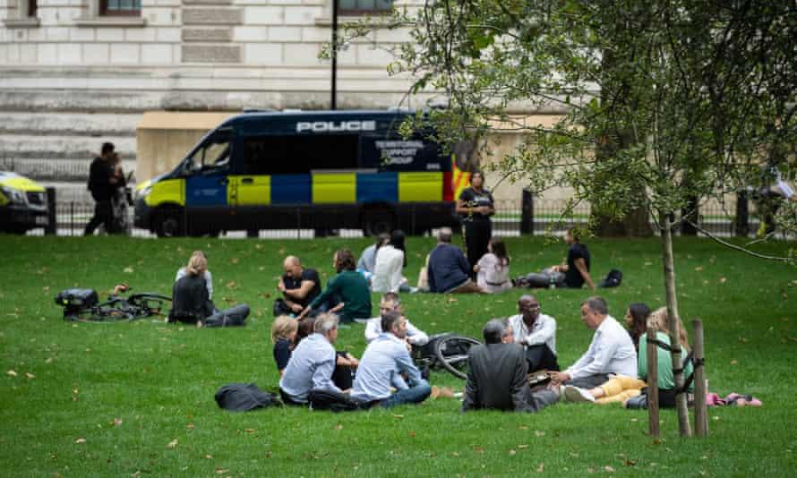People meet in St James's Park in Westminster.