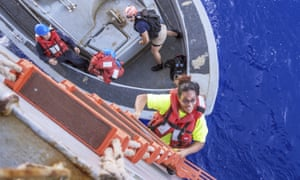 Tasha Fuiaba climbs the accommodation ladder to board the amphibious dock landing ship USS Ashland on 25 October 2017, after the Navy ship rescued her.