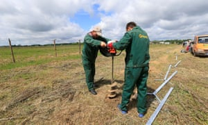 Workers drill a hole for a fence at Sudargas border crossing point with Lithuania and Kaliningrad in Ramoniškiai.