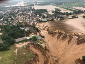 Erftstadt, Germany: Houses in Erftstadt-Blessem have been submerged and some have collapsed due to flooding caused by thunderstorms. The death toll has risen to more than 120.