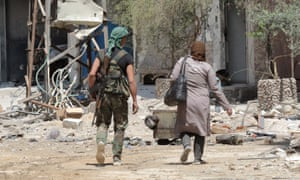 Syrian soldier walks with woman