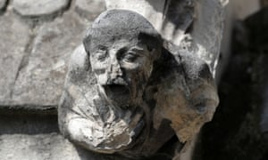 Damaged gargoyle at Notre Dame cathedral.