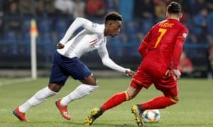 Callum Hudson-Odoi takes on Montenegro's Marko Vesovic during England's 5-1 victory in Podgorica