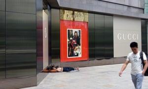Homeless man in Guiyang's Gucci