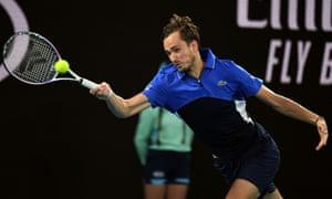 Daniil Medvedev hits a return against Frances Tiafoe.