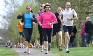 A running group training on a canal towpath.