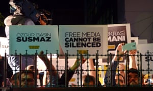 Protesters oppose the arrest of newspaper editor Bulent Kenes in Istanbul on Friday.