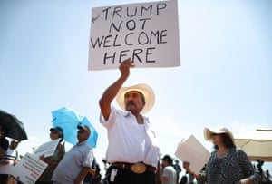 Miguel de Anda, born and raised in El Paso, holds a sign reading 'Trump Not Welcome Here' at a protest against Trump's visit, following a mass shooting, which left at least 22 people dead on 7 August 2019 in El Paso, Texas.