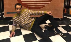 Raven lying down on checkerboard floor