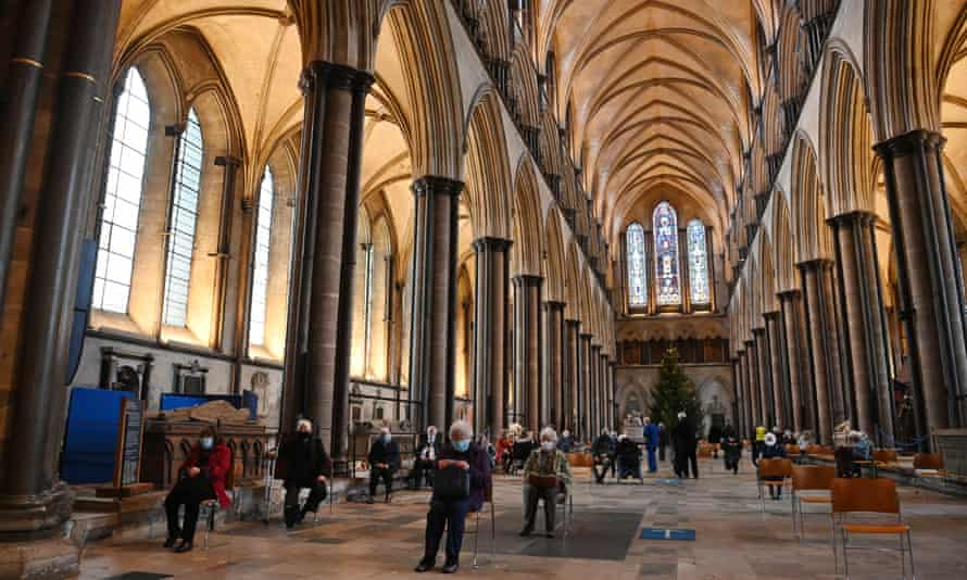 People rest in Salisbury Cathedral, England, after receiving the Pfizer/BioNTech vaccine.