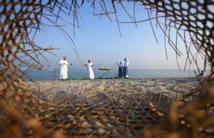 Dalma island, United Arab Emirates: Fishermen set up nets on the shore during the Dalma sailing festival