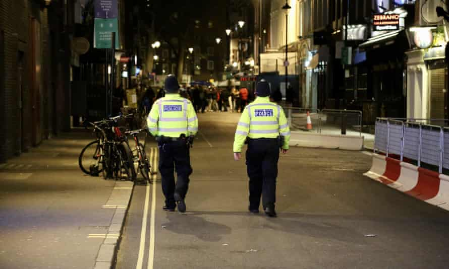 Police patrol the Soho area in London after restaurants and pub reopened