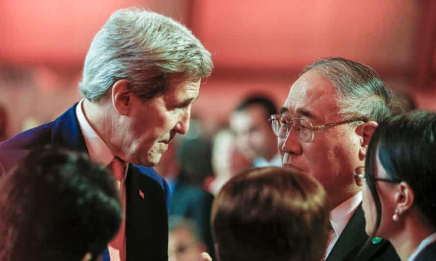 John Kerry talks with China's special representative on climate change Xie Zhenhua during the COP21 talks north of Paris.