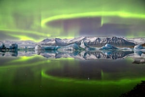 Aurora over a glacier lagoon by James Woodend.