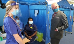 the Prince of Wales meeting with frontline health and care workers administering and receiving the Covid-19 vaccine at the Gloucestershire Vaccination Centre at Gloucestershire Royal Hospital today.