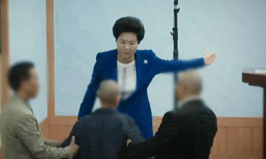 Shin Ok-ju slaps one of her followers.
