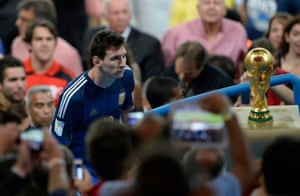 Lionel Messi looks wistfully at the trophy following Argentina's defeat to Germany in the 2014 World Cup final