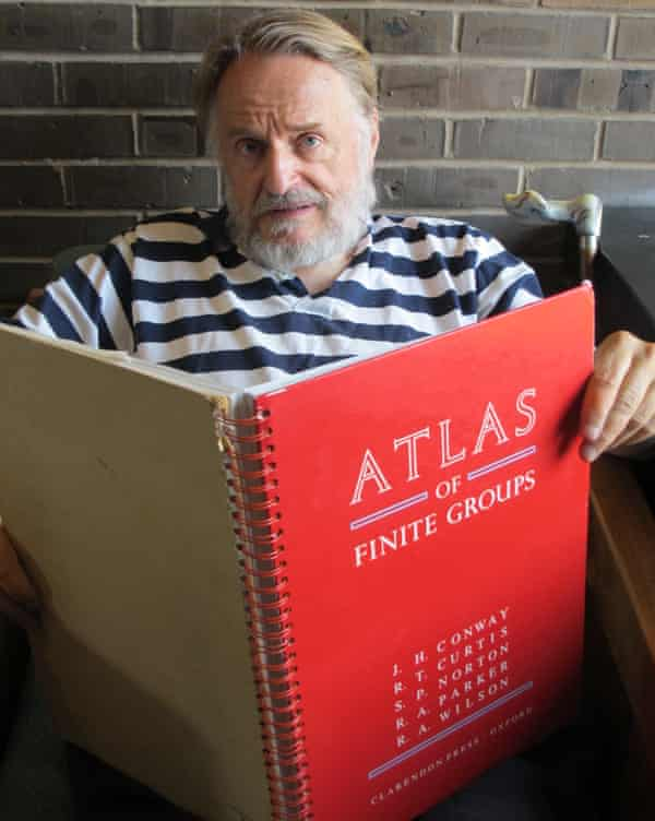 John Horton Conway with the Atlas of Finite Groups (1985), co-authored by Simon Norton, Robert Curtis, Richard Parker and Robert Wilson.