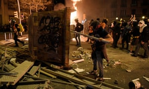 Protesters make barricades during a demonstration called by the local Republic Defence Committees (CDR) in Barcelona on Wednesday.