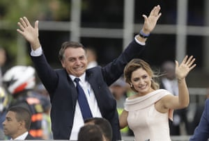 Jair and Michelle Bolsonaro in an open car after his swearing-in ceremony in Brasilia