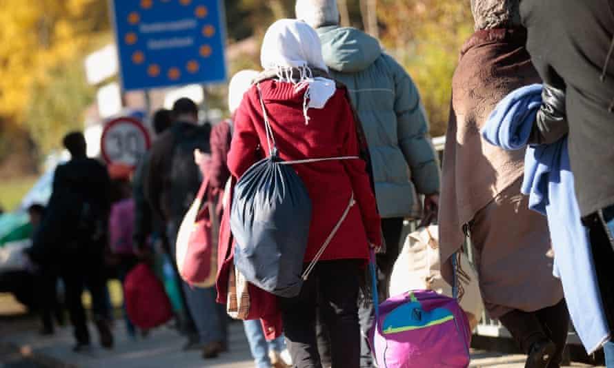 Migrants cross the Germany-Austria border.
