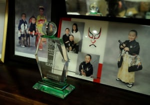 A trophy is displayed alongside family photos at home