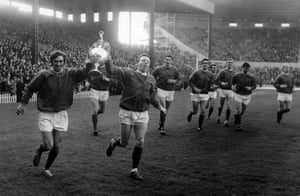 Best, left, and Nobby Stiles hold aloft the League Championship trophy at Old Trafford at the end of the 1964-65 season.
