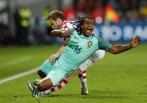 Croatia's Ivan Rakitic takes out Portugal's Renato Sanches.