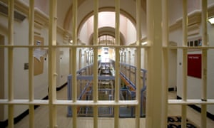 Looking through prison bars into a cell block in Wandsworth Prison. Wandsworth Prison is one of the largest prisons in the UK.