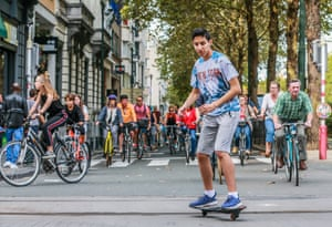 Europe should hold an annual car-free day in a bid to ease air pollution, the mayors of Paris and Brussels have said. Here's a skateboarder taking part in Brussels
