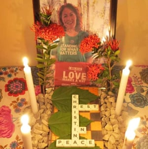 "Shrine for Christina Coombe, who died in May 2019, with candles and a sign reading ""Rest in peace"""