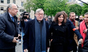 The rector of Notre Dame Cathedral, Patrick Chauvet (centre), and the mayor of Paris, Anne Hidalgo, arrive at the scene