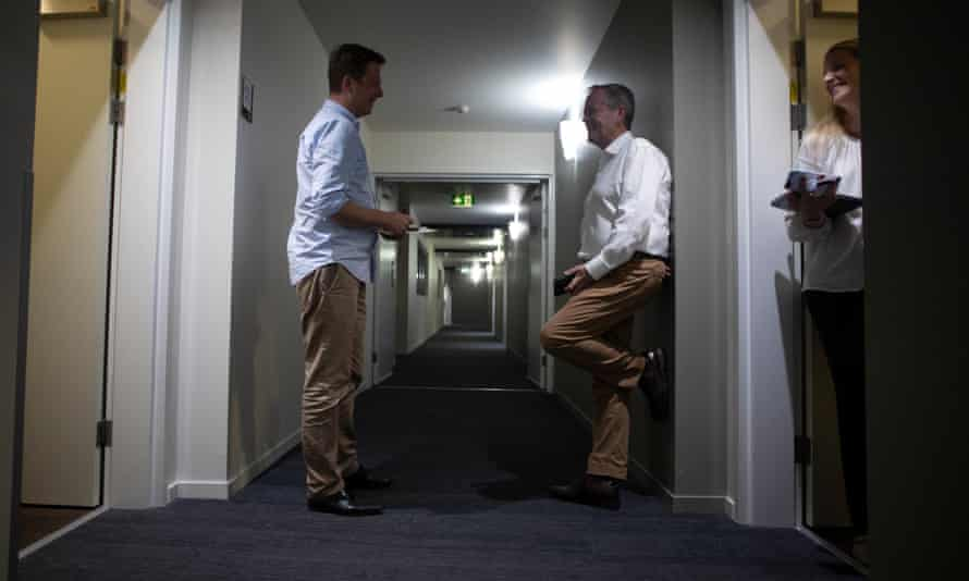 Bill Shorten chats with staff in the corridor of his hotel in Townsville