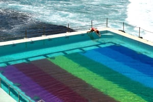 Sydney, Australia. A swimmer dives into Bondi Icebergs pool, which has been transformed into a 50m rainbow flag by the footwear brand Havaianas to celebrate the LGBTQIA+ community