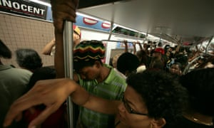 New York subway commuters on a crowded train.