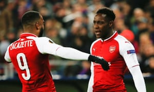Danny Welbeck celebrates with team-mate Alexandre Lacazette after scoring a vital away goal.