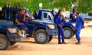 Sudanese security forces outside the court in Khartoum before the trial of Omar al-Bashir