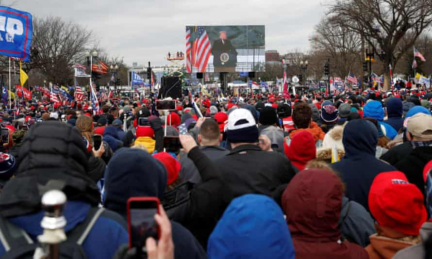 President Donald Trump is seen on a screen speaking to supporters during a rally to contest the certification of the 2020 US presidential election results in Washington on 6 January.