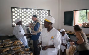 Celebrity Chef and Restaurateur Jose Andres visiting Haiti.World Central Kitchen constructed this building on the grounds of the Saint Andre de Palmis Tempe school with a kitchen where students and teachers use for learning as well as their cafeteria. The food is prepared by members of the community. They gather the food from their community garden and cook the food. Photographed on March 20, 2014. Celebrity chef and restaurateur helps prepare food in the kitchen.