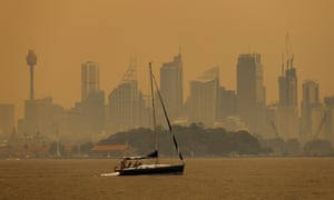 Smoke haze from bushfires shrouds Sydney Harbour.