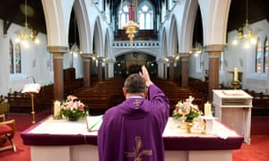 A priest says mass in an empty church Rathfarnham, Dublin, during Ireland's first lockdown in March
