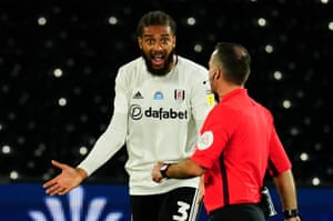 Michael Hector of Fulham questions a decision from the referee.